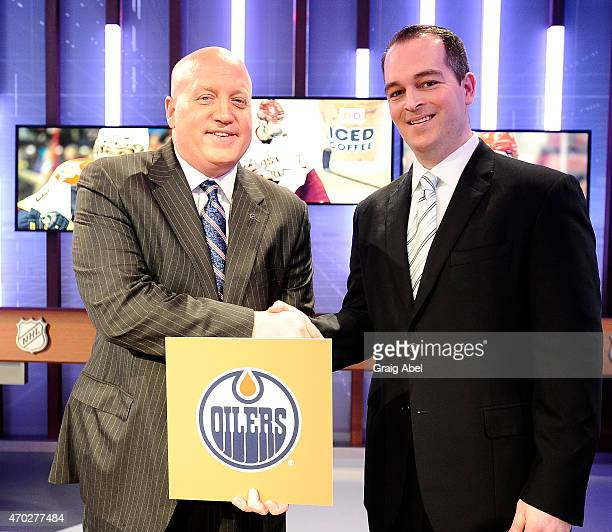 Deputy Commisioner Bill Daly congratulates Edmonton Oilers Assistant General Manager Bill Scott on the 1st overall pick at the National Hockey League...