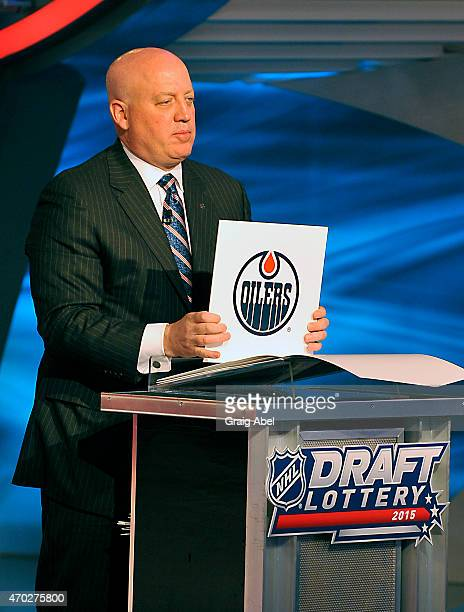 Deputy Commisioner Bill Daly of The National Hockey League displays the Edmonton Oilers card after the Oilers won the first overall pick at the Draft...