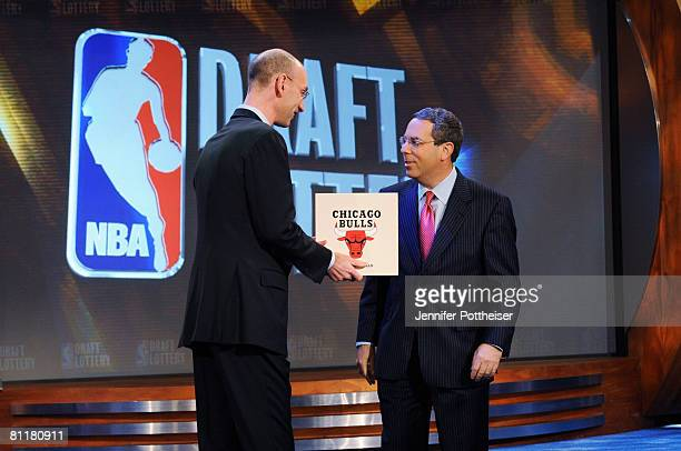 Deputy Commissioner Adam Silver congratulates Steve Schanwald Executive Vice President of Baketball Operations of the Chicago Bulls during the 2008...