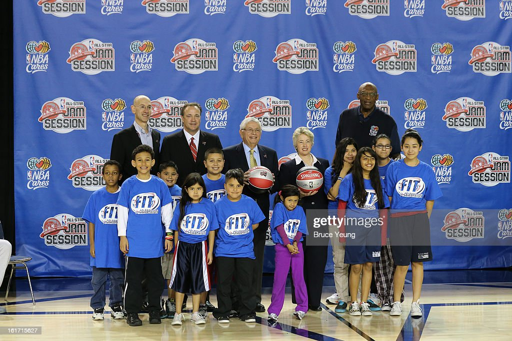NBA Deputy Commissioner Adam Silver, Houston Rockets Chief Executive Officer Tad Brown, NBA Commissioner David Stern, The Honorable, Annise Parker, Mayor, City of Houston and NBA Cares Ambassador/Special Assistant to the Commissioner Bob Lanier pose for a photo with children during the Opening Ceremony/NBA All-Star FIT Youth Celebration presented by Exxon Mobile on Center Court during the 2013 NBA Jam Session on February 14, 2013 at the George R. Brown Convention Center in Houston, Texas.