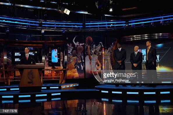Deputy Commissioner Adam Silver stands on the stage with Atlanta Hawks representative Dominique Wilkins Seattle SuperSonics representative Lenny...