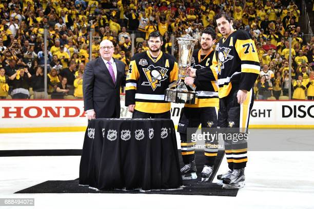 NHL Deputy Commissioner Bill Daly Chris Kunitz Sidney Crosby and Evgeni Malkin of the Pittsburgh Penguins pose with the Prince of Wales Trophy after...