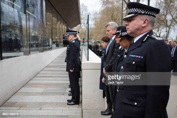Deputy Commissioner Craig Mackey and other members of Metropolitan Police's senior management observe a minute's silence outside New Scotland Yard...