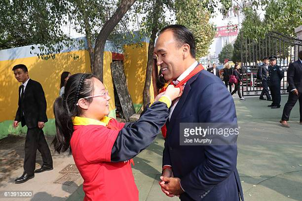 Deputy Commissioner Mark Tatum gets a scarf during the NBA Cares Learn and Play Center Dedication part of the 2016 Global Games China at Huangzhuang...