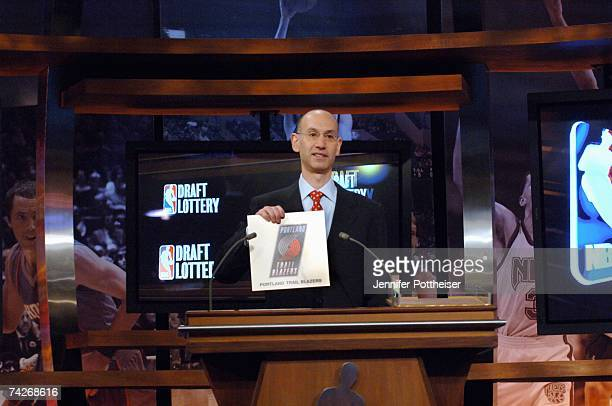 Deputy Commissioner of the NBA Adam Silver holds the card for the Portland Trail Blazers who are awarded the number one overall pick during the 2007...