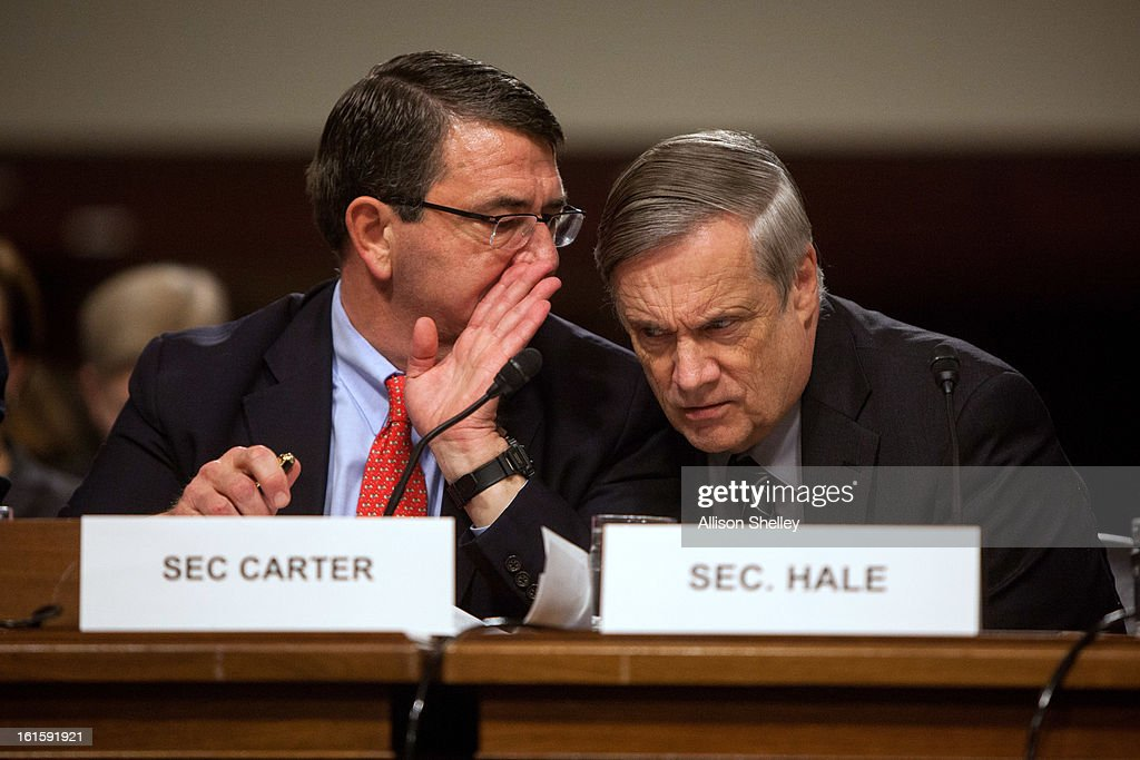 Deputy Defense Secretary Ashton Carter and Defense Undersecretary Robert Hale confer during a hearing before the Senate Armed Services Committee on...