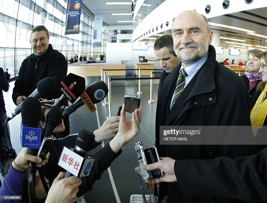 Deputy Director General and Head of the Department of Safeguards Herman Nackaerts (C) talks with journalists as he leaves for another trip with his team to Iran on February 12, 2013 at the Airport Schwechat, near Vienna, Austria. Iran hinted that inspection of the Parchin military site by the International Atomic Energy Agency would be possible in the context of a 'comprehensive agreement' that recongnises its right to peaceful nuclear energy. AFP PHOTO / DIETER NAGL