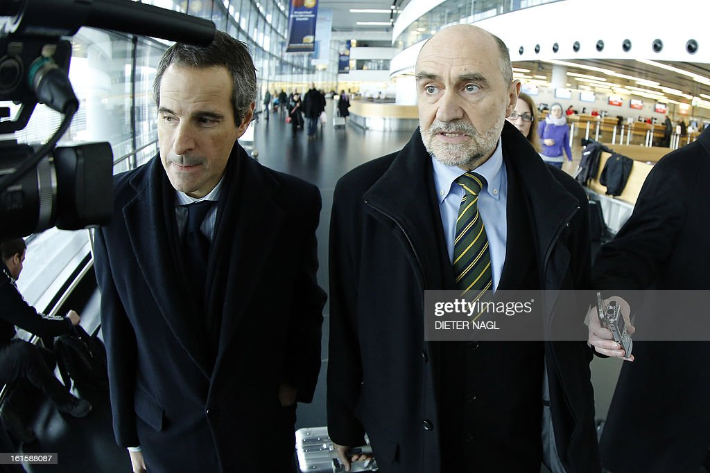 Deputy Director General and Head of the Department of Safeguards Herman Nackaerts (R) talks with journalists as he leaves for another trip with his team to Iran on February 12, 2013 at the Airport Schwechat, near Vienna, Austria. Iran hinted that inspection of the Parchin military site by the International Atomic Energy Agency would be possible in the context of a 'comprehensive agreement' that recongnises its right to peaceful nuclear energy.