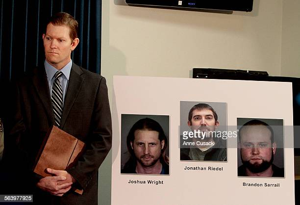 Deputy district attorney Blake Heller stands next to photos of the three suspects Joshua Wright of Moorpark Ca left Jonathan Riedel from West Jordan...