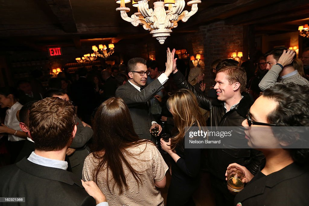 GQ Deputy Editor/author Michael Hainey (C) attends the GQ 'After Visiting Friends' book party on February 21, 2013 in New York City.
