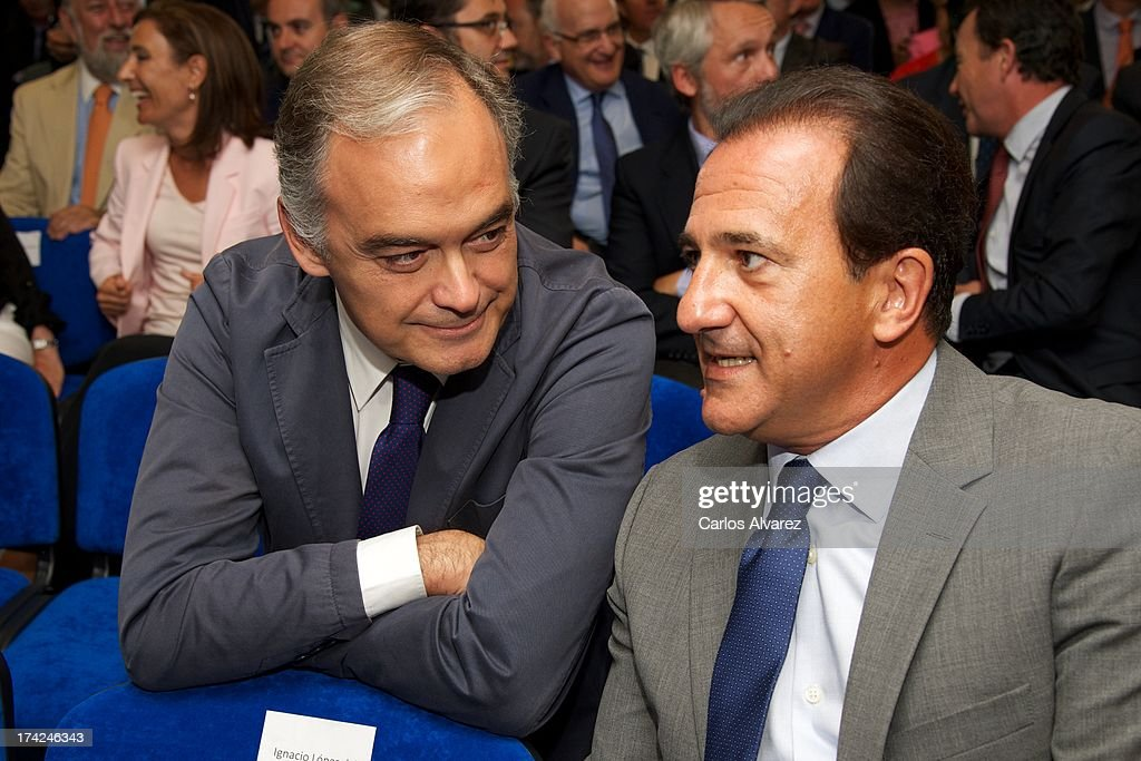 PP Deputy Esteban Gonzalez Pons (L) and Jose Miguel Contreras (R) attend the 'La Razon' newspaper meeting on July 22, 2013 in Madrid, Spain. Maria Dolores de Cospedal has said that the prime minister Mariano Rajoy will go to parliament to talk about corruption cases involving the government.