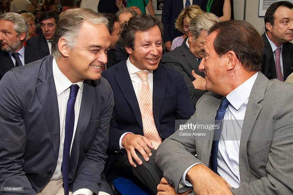 PP Deputy Esteban Gonzalez Pons Carlos Floriano and Jose Miguel Contreras attend the 'La Razon' newspaper meeting on July 22 2013 in Madrid Spain...