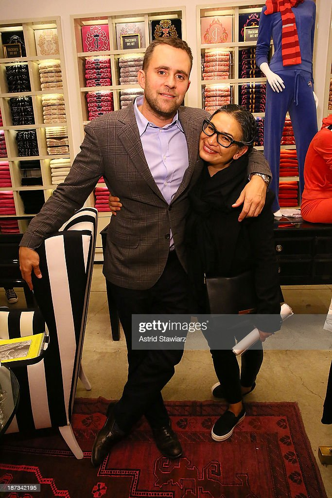 Deputy Fashion Director at Vanity Fair, Michael Carl and Anjali Lewis attend the Vanity Fair & Juicy Couture 'Wild For Gifts' Celebration on November 7, 2013 in New York City.