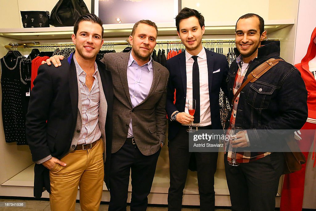 Deputy Fashion Director at Vanity Fair, Michael Carl (2nd to left) poses with guests during the Vanity Fair & Juicy Couture 'Wild For Gifts' Celebration on November 7, 2013 in New York City.