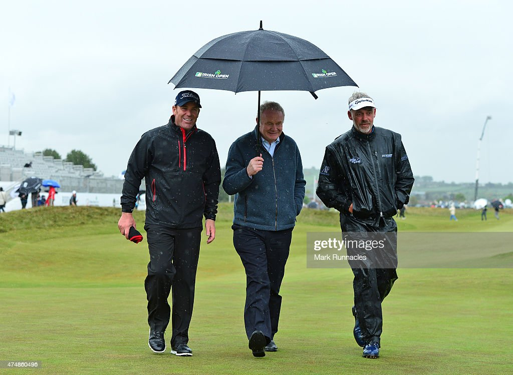 Deputy First Minister Martin McGuinness (C), former Australian cricketer Shane Warne (L), and Darren Clarke of Northern Ireland walk from the 18th green after playing in the Pro-Am during the Irish Open Previews at Royal County Down Golf Club on May 27, 2015 in Newcastle, United Kingdom.