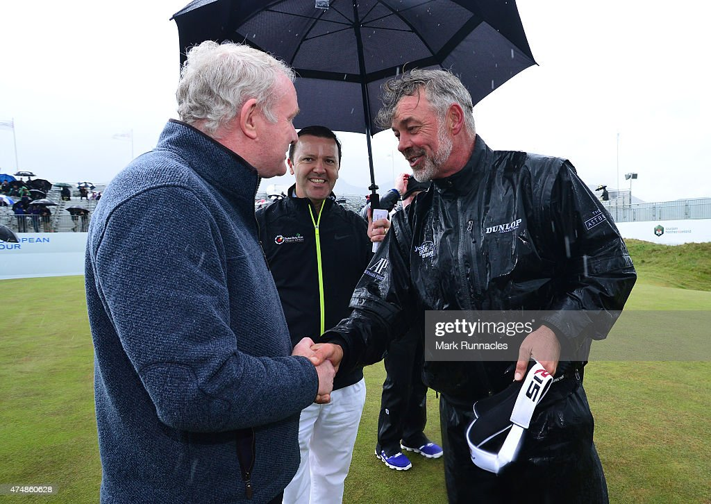 Deputy First Minister Martin McGuinness (L), meets Darren Clarke of Northern Ireland on the 18th green after the morning Pro-Am during the Irish Open Previews at Royal County Down Golf Club on May 27, 2015 in Newcastle, United Kingdom.