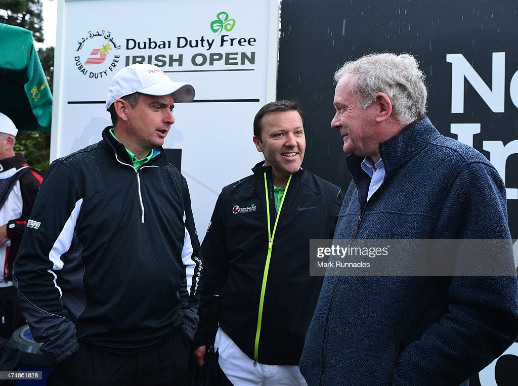 Deputy First Minister Martin McGuinness (R), talking with Peter Lawrie of Ireland on the 1st tee during the afternoon Pro-Am during the Irish Open Previews at Royal County Down Golf Club on May 27, 2015 in Newcastle, United Kingdom.