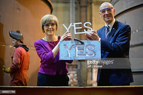 Deputy First Minister Nicola Sturgeon and Cabinet Secretary for Finance John Swinneyvisit Steel Engineering on September 16 2014 in Renfrew Scotland...