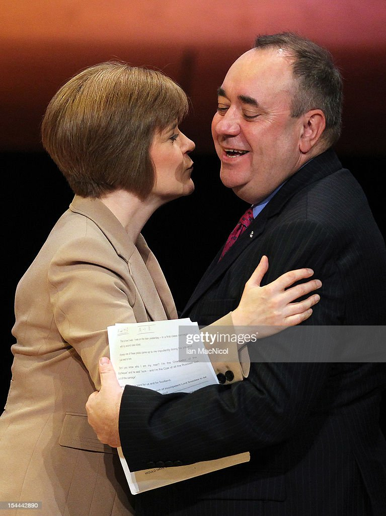 Deputy First Minister <a gi-track='captionPersonalityLinkClicked' href=/galleries/search?phrase=Nicola+Sturgeon&family=editorial&specificpeople=2582617 ng-click='$event.stopPropagation()'>Nicola Sturgeon</a> greets The Scottish First Minister <a gi-track='captionPersonalityLinkClicked' href=/galleries/search?phrase=Alex+Salmond&family=editorial&specificpeople=857688 ng-click='$event.stopPropagation()'>Alex Salmond</a> as he speaks at The SNP Annual Conference on October 20, 2012 in Perth, Scotland. The First Minister delivered his key note speech today after signing a deal with David Cameron earlier in the week for Scotland's referendum to take place in the autumn of 2014.