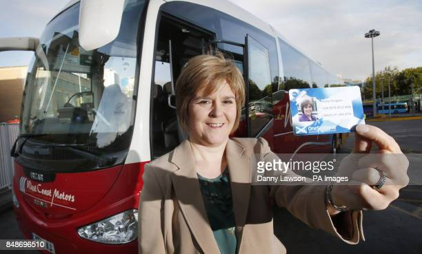 Deputy First Minister Nicola Sturgeon holds up the new Scotlandwide travel smart card during a visit to Buchanan Street Bus Station in Glasgow