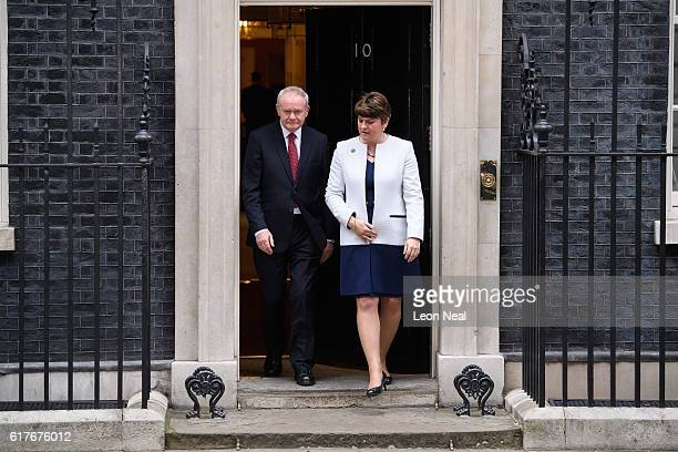 Deputy First Minister of Northern Ireland Martin McGuinness and First Minister of Northern Ireland Arlene Foster leave after a meeting between...