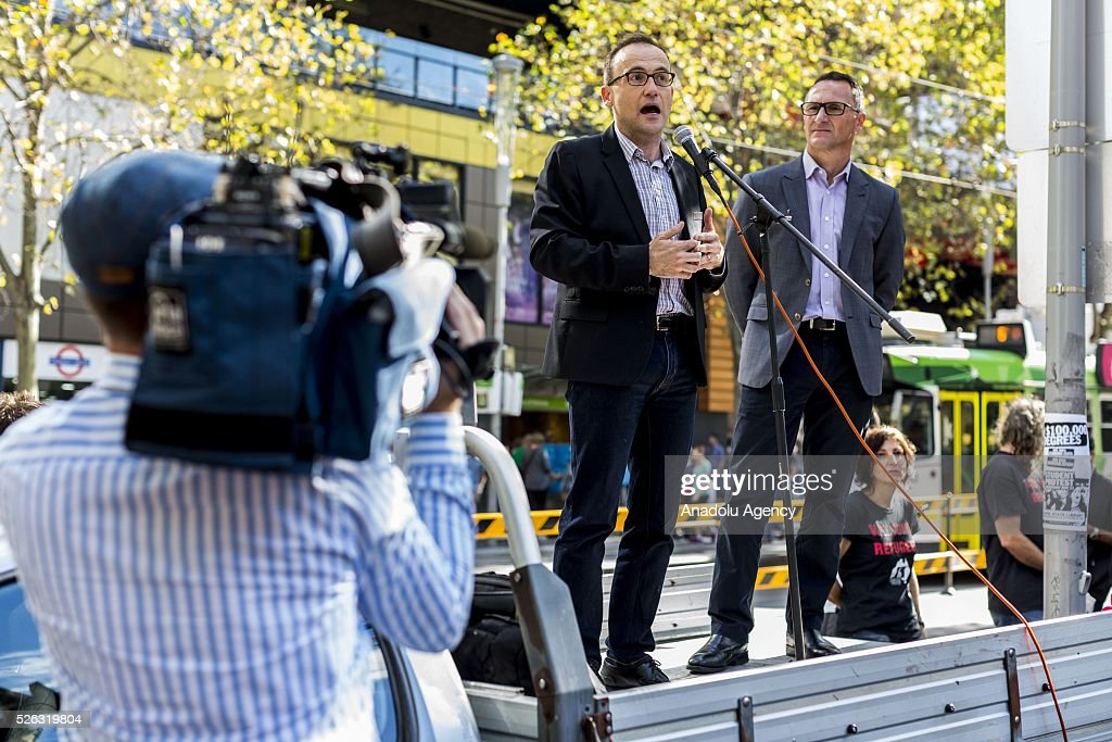 Deputy Greens leader Adam Bandt delivers a speech as Greens leader Richard Di Natale standing next to him during a protest demanding that asylum seekers held in off shore detention to be brought to Australia at a rally in Melbourne, Australia on April 30, 2016. Protests have started after The Papua New Guinean Supreme Court ruled that the Australian-run detention centres on Manus Island were illegal and unconstitutional.