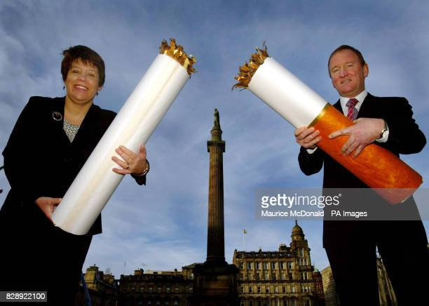 Deputy Health Minister Tom McCabe and Lesley Hinds the Chair of NHS Health Scotland hold a broken cigarette in Glasgow's George Square to launch a 4...