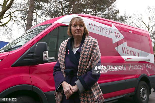 Deputy Labour leader Harriet Harman stands next a pink van launched during a Labour campaign aimed at women voters before a speech on February 11...