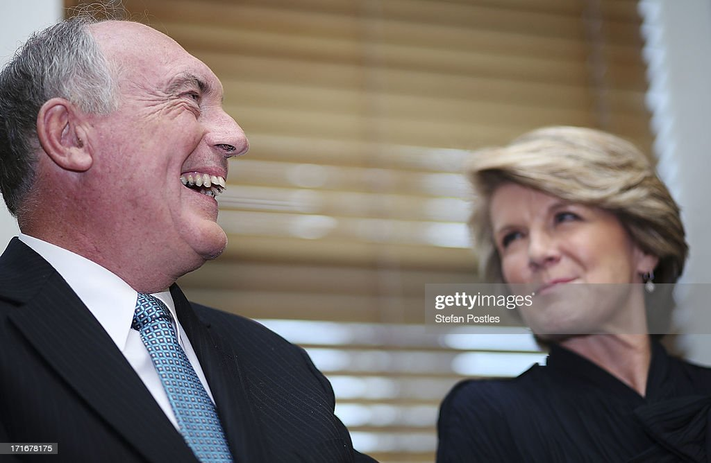 Deputy Leader <a gi-track='captionPersonalityLinkClicked' href=/galleries/search?phrase=Julie+Bishop&family=editorial&specificpeople=1198450 ng-click='$event.stopPropagation()'>Julie Bishop</a> and Nationals Leader Warren Truss listen to Opposition Leader Tony Abbott speak to Coalition MPs in the party room on June 28, 2013 in Canberra, Australia. Abbott questioned the credibility of Kevin Rudd's new front bench during his address to Coalition MPs, one day after Kevin Rudd was sworn in as Prime Minister following a Labor party leadership ballot.