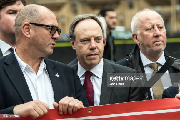 Deputy Leader of the Democratic Unionist Party and MP for Belfast North Nigel Dodds meets workers from the Bombardier factory in Belfast as workers...