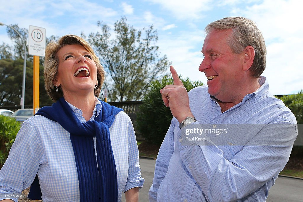 Deputy Leader of the Opposition <a gi-track='captionPersonalityLinkClicked' href=/galleries/search?phrase=Julie+Bishop&family=editorial&specificpeople=1198450 ng-click='$event.stopPropagation()'>Julie Bishop</a> laughs with West Australian Premier Colin Barnett after voting at the Cottesloe Civic Centre in the electorate of Curtin on election day on September 7, 2013 in Perth, Australia. Voters head to the polls today to elect the 44th parliament of Australia.