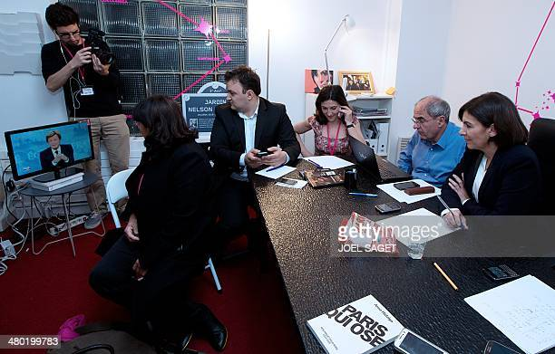 Deputy Mayor and French Socialist party candidate for the Paris municipal elections Anne Hidalgo follows with her staff the latest elections results...