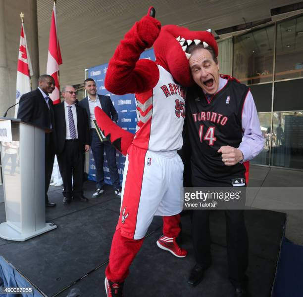 TORONTO ON MAY 12 Deputy Mayor Norm Kelly has a little fun with the Raptor mascot after he announced that today is 'Raptors Day' in celebration of...