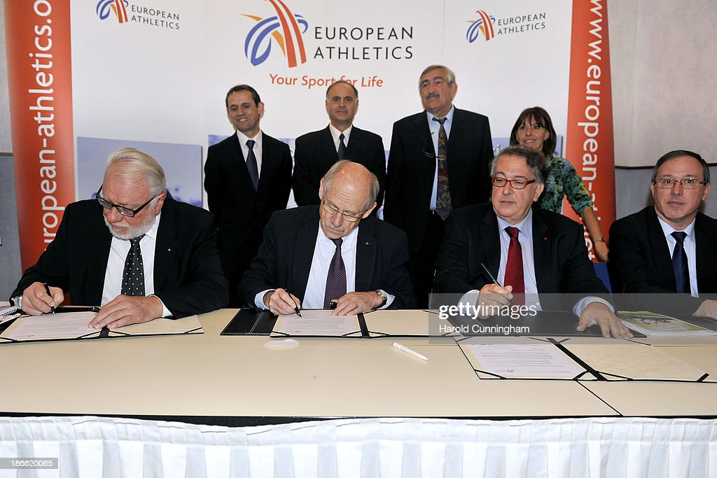 Deputy Mayor of Paray-le-Monial Michel Travely, European Athletics President Hansjörg Wirz, French Athletics Federation President Bernard Amsalem and European Athletics Vice President Jean Gracia sign the contract as Christophe Halleumieux, Claude Monnet, Pierre Weiss, and former World Cross Country Championships gold medallist Annette Sergent-Petit look on as Paray-le-Monial is awarded to host the 2015 European Cross Country Championships during the European Athletics event allocations as part the European Athletics council meeting on November 2, 2013 in Zurich, Switzerland.