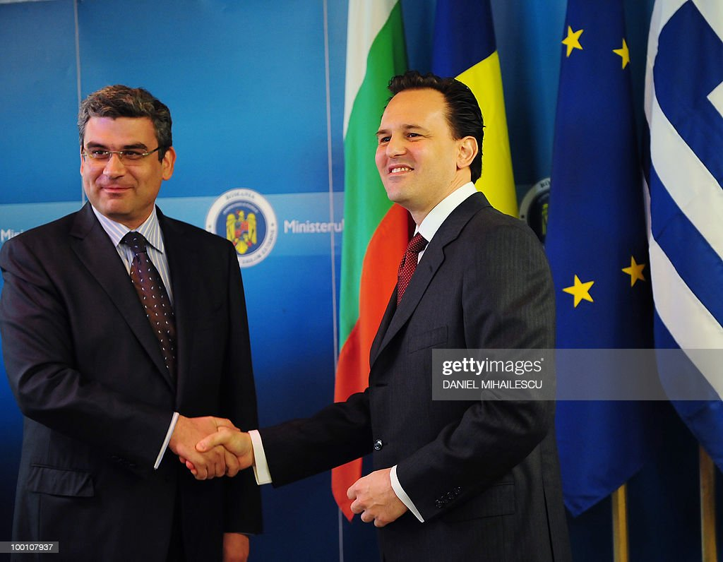 deputy Minister of Greek Foreign Affairs Dimitris Droutsas (R) shakes hands with Romanian Foreign Minister Teodor Baconschi in Bucharest May 21, 2010 at the beginning of the seventh tri-lateral Foreign Ministers meeting between Romania, Greece, and Bulgaria.