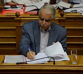 Deputy Minister of the Interior and Administrative Reconstruction Yannis Balafas talks at the Greek parliament Greek legislatotors discus on a first...