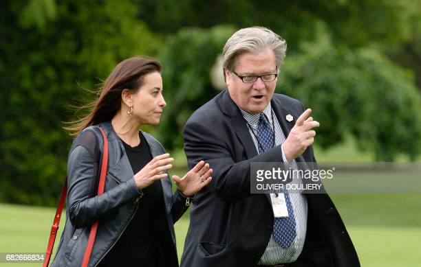 Deputy National Security adviser Dina Powell and strategist Steve Bannon exit Marine One on the South Lawn of the White House in Washington DC on May...