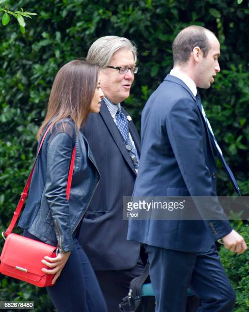 Deputy National Security Advisor for Strategy Dina Powell Senior Advisor Stephen Miller and Chief Strategist Steve Bannon disembark from Marine One...