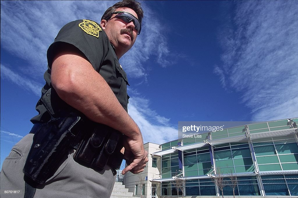 Deputy Neil Gardner outside Columbine High School police officer assigned to school on day of April assault by student gunmen Eric Harris Dylan...