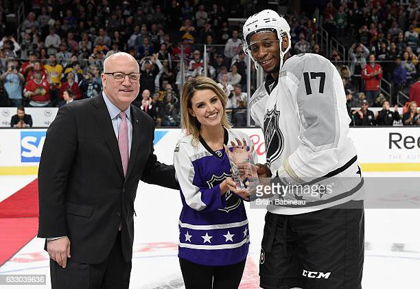 Deputy NHL Commissioner Bill Daly and anthem singer Courtney Daniels present Wayne Simmonds of the Philadelphia Flyers with the 2017 Honda NHL...