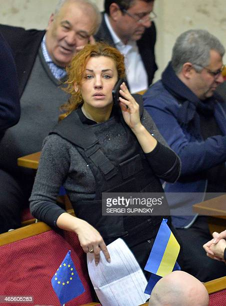 Deputy of the opposition party Batkivshchyna Lesya Orobets wears a bulletproof vest during an extraordinary session of the Ukrainian parliament on...