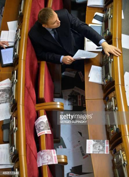 A deputy of the Ukrainian Parliament sits amongst leaflets after a supporter of Yulia Tymoshenko threw leaflets depicting the jailed Ukrainian...