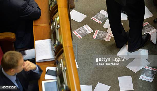 A deputy of the Ukrainian Parliament stands amongst leaflets after a supporter of Yulia Tymoshenko threw leaflets depicting the jailed Ukrainian...