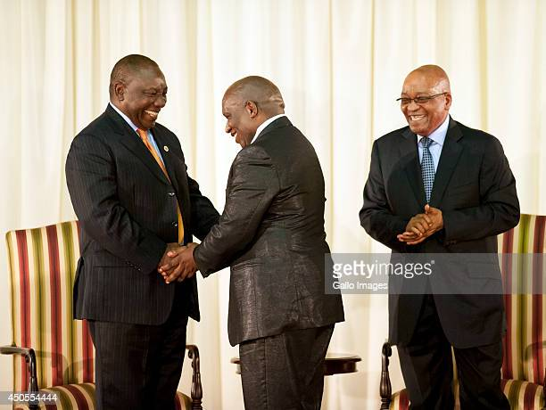 Deputy President Cyril Ramaphosa and President Jacob Zuma congratulate the new ministers during the swearingin ceremony on May 25 2014 in Pretoria...