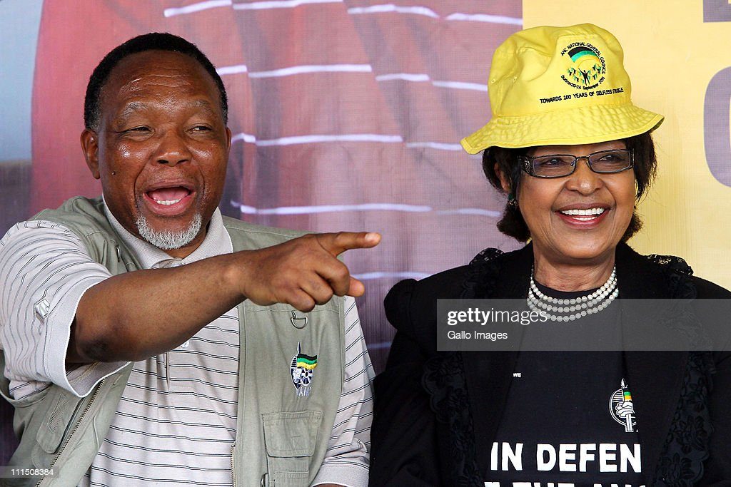 Deputy President Kgalema Motlanthe (L) speaks as African National Congress (ANC) stalwart, Winnie Madikizela-Mandela smiles during an ANC election rally held in Meyerton on April 3, 2011 near Johannesburg, South Africa.
