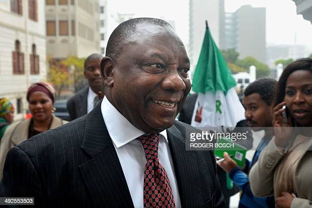 Deputy president of the ANC party Cyril Ramaphosa arrives to take part in the first session of the newly elected South African parliament on May 21...
