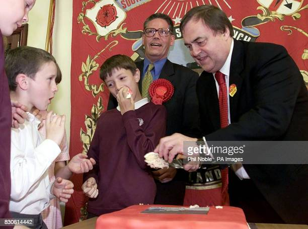 Deputy Prime Minister John Prescott dishes out cake to school children at the Penworthan Community centre near Leyland in Lancashire Mr Prescott...