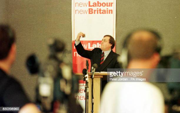 Deputy Prime Minister John Prescott holds a Labour Party election promise pledge card during his keynote speech delivered to Labour Party members in...