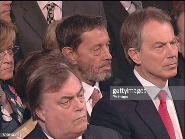 Deputy Prime Minister John Prescott Secretary of State for Work and Pensions David Blunkett and British Prime Minister Tony Blair listen as Britain's...