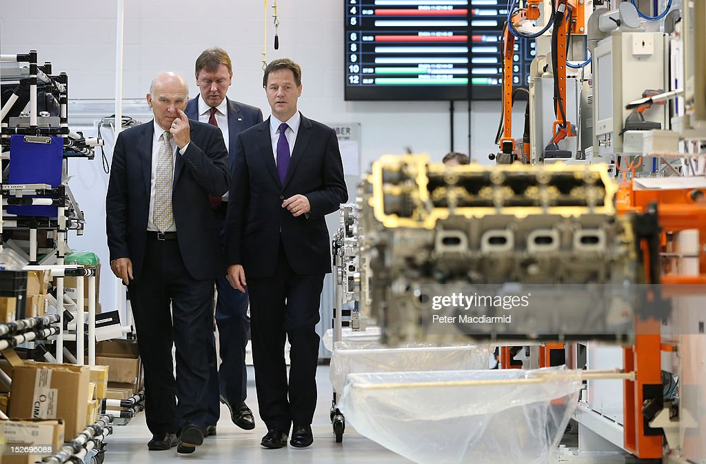 Deputy Prime Minister <a gi-track='captionPersonalityLinkClicked' href=/galleries/search?phrase=Nick+Clegg&family=editorial&specificpeople=579276 ng-click='$event.stopPropagation()'>Nick Clegg</a> (R) and Business Secretary <a gi-track='captionPersonalityLinkClicked' href=/galleries/search?phrase=Vince+Cable&family=editorial&specificpeople=4872939 ng-click='$event.stopPropagation()'>Vince Cable</a> (L) walk with Ricardo UK Managing Director Martin Fausset during a visit to the Ricardo Engine Assembly plant on September 24, 2012 in Shoreham-by-Sea, England. Later the Business Secretary <a gi-track='captionPersonalityLinkClicked' href=/galleries/search?phrase=Vince+Cable&family=editorial&specificpeople=4872939 ng-click='$event.stopPropagation()'>Vince Cable</a> will announce a new bank to enable easier lending to businesses.